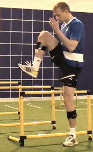 Ritchie De Laat of Leicester City FC performing hurdle walks.